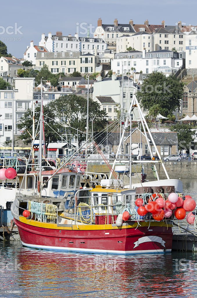 Trawler in harbor of St. Peter Port on Guernsey stock photo