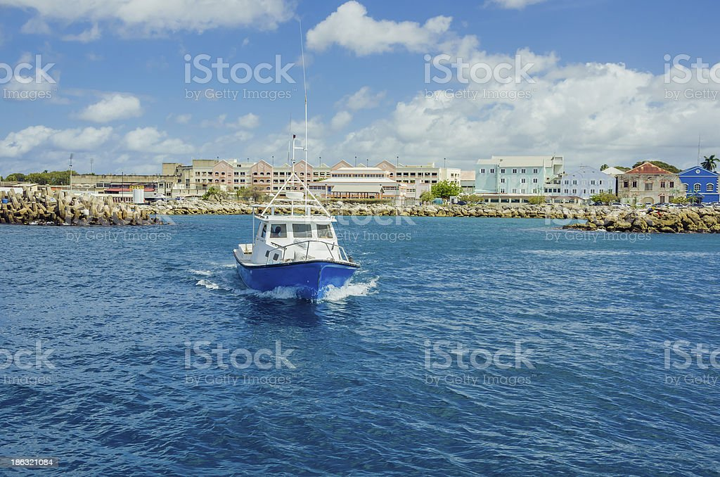 Trawler Leaving a Harbour stock photo