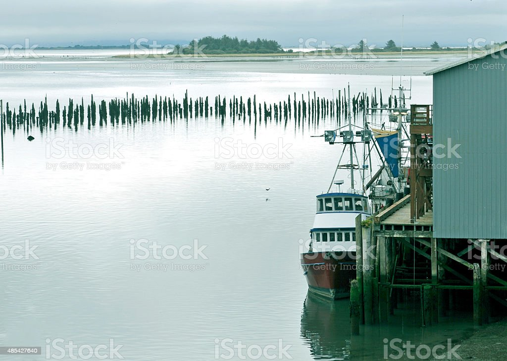 Trawlers in harbor from Pacific Ocean at Washington state stock photo