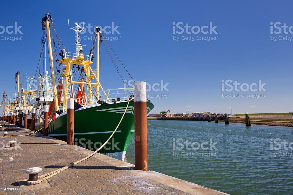 Trawlers in the harbour of Oudeschild, Texel island, The Netherlands stock photo