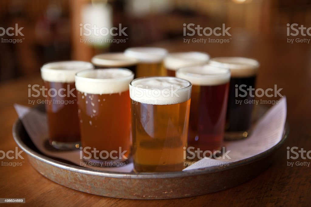 Tray filled with eight beer samplers stock photo