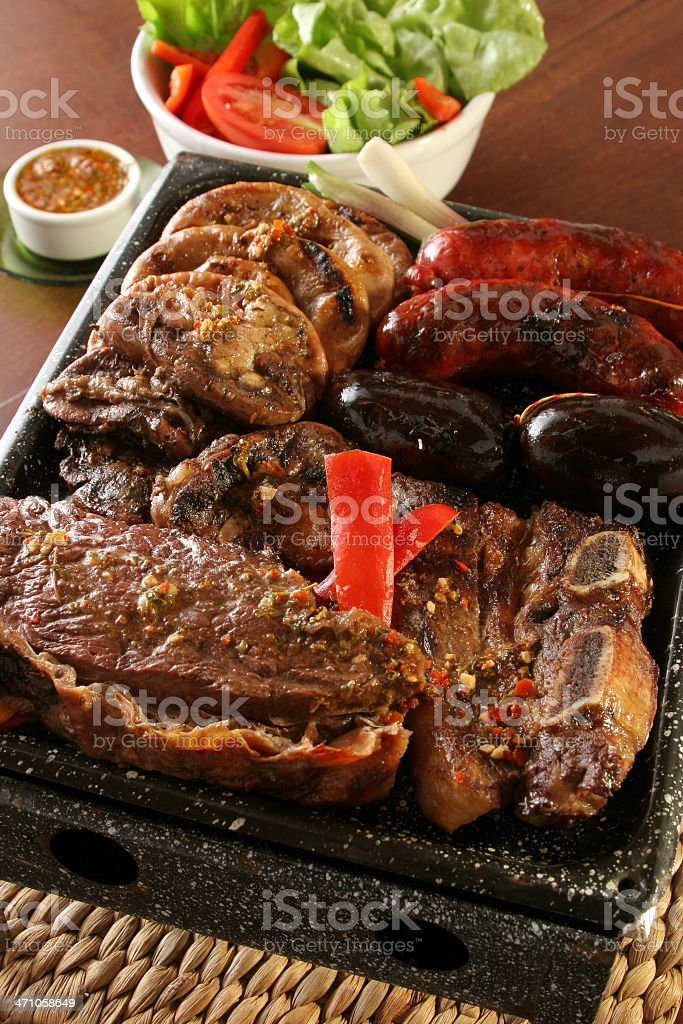 Tray full of different meat and a side bowl of salad and dip royalty-free stock photo