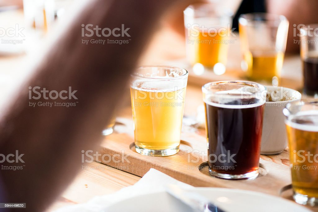 Tray Of A Variety Of Filled Beer Tasting Glasses stock photo
