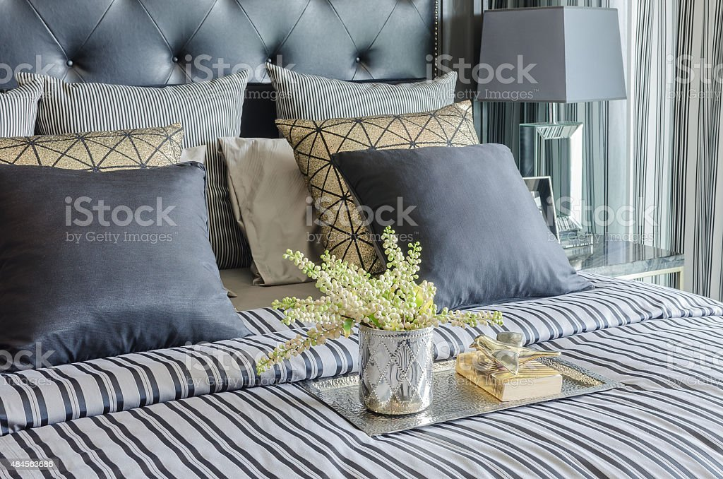 tray of book with vase of  plant on bed stock photo