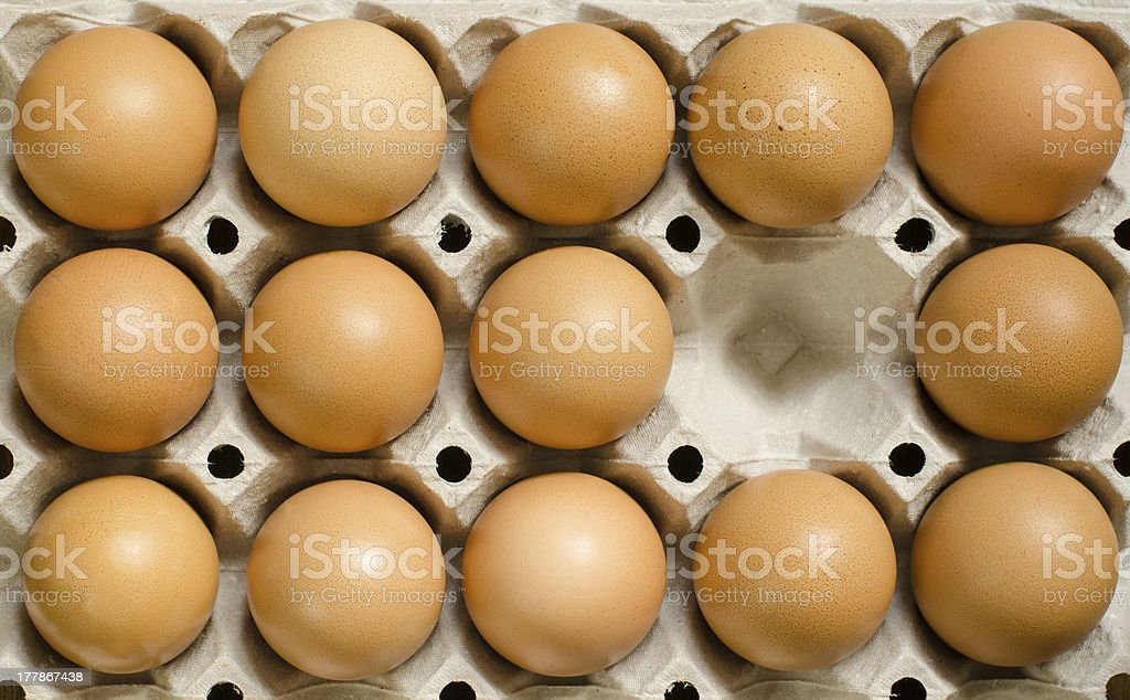 Tray of brown eggs royalty-free stock photo