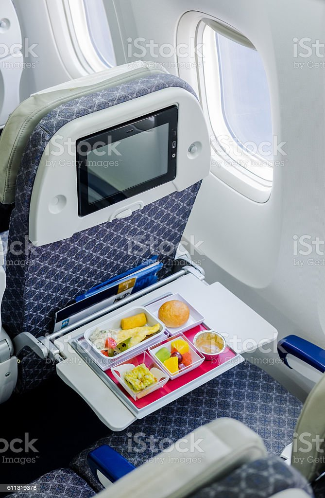 Tray of food on the plane stock photo