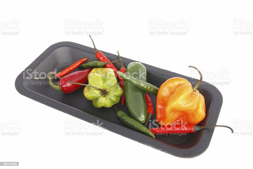 tray of mixed chili peppers royalty-free stock photo
