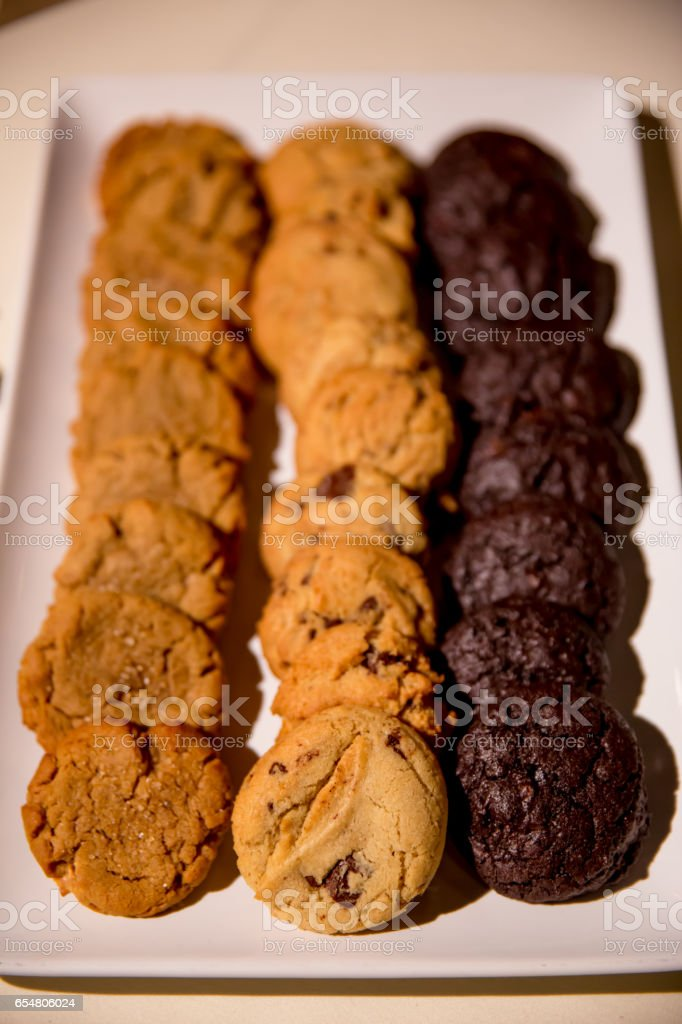 A Tray of Peanut Butter, Chocolate Chip, and Chocolate Cookies stock photo