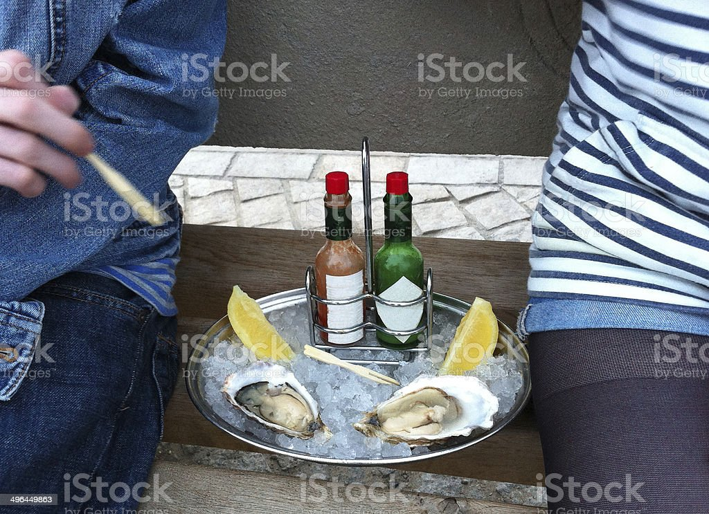 Tray of Shucked Oysters on crushed ice with Pepper Sauce stock photo