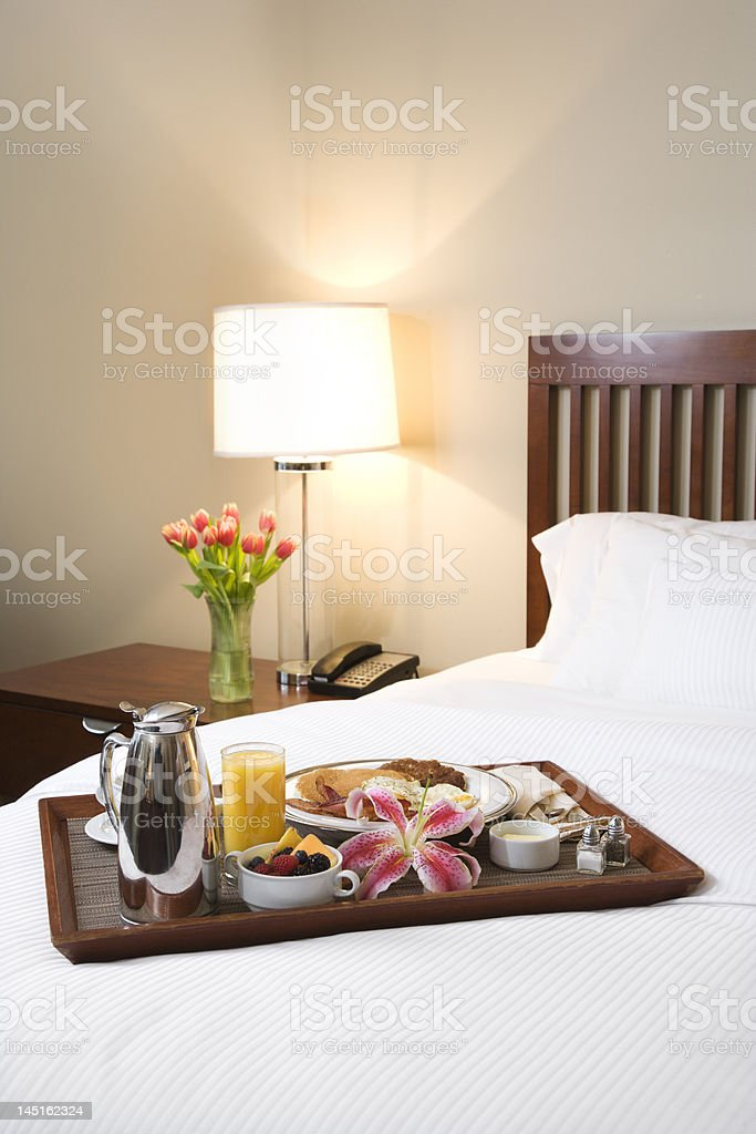 Tray with breakfast food on top of bed. royalty-free stock photo