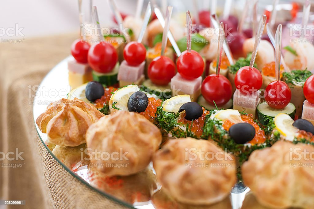 Tray with canape at buffet stock photo