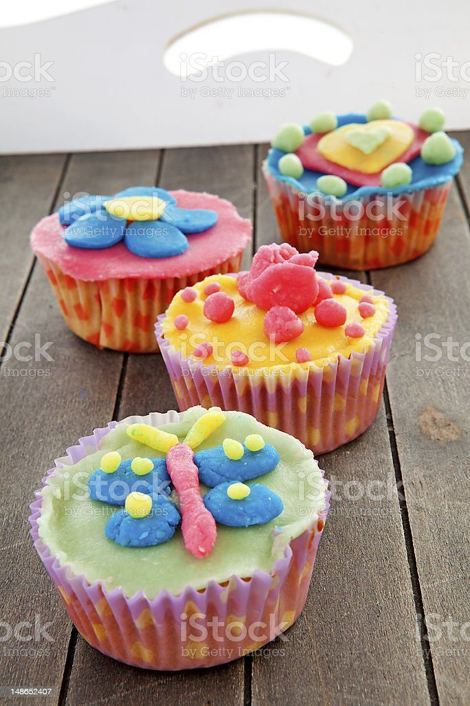 Tray with colorful decorated cupcakes royalty-free stock photo