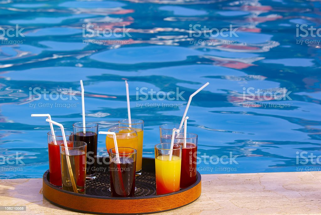 tray with many drinks on the poolside stock photo
