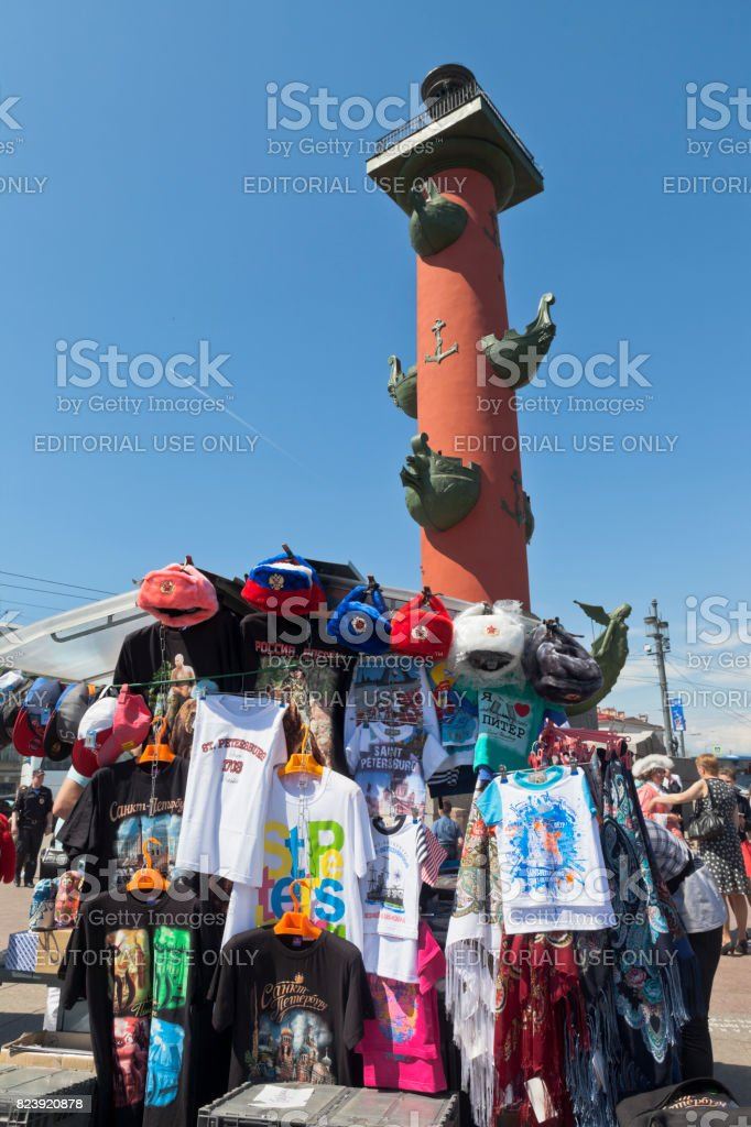 Tray with souvenirs against the background of the Rostral column in St. Petersburg stock photo