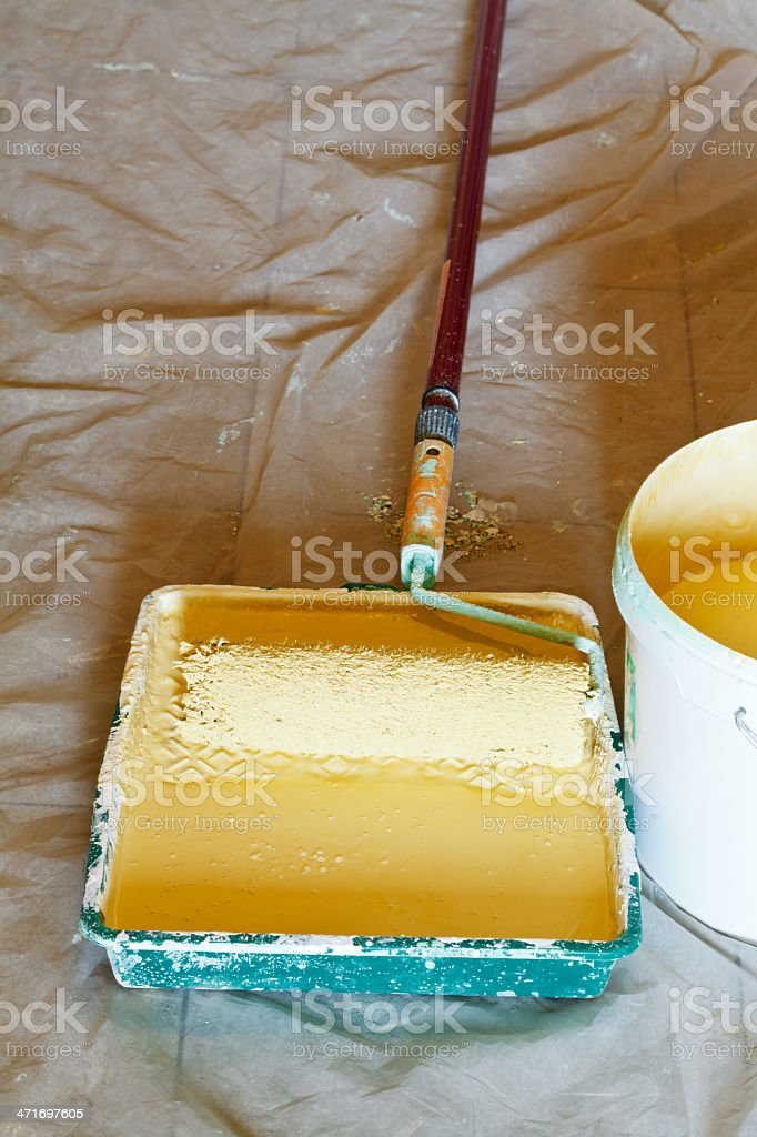 tray with yellow emulsion paint stock photo
