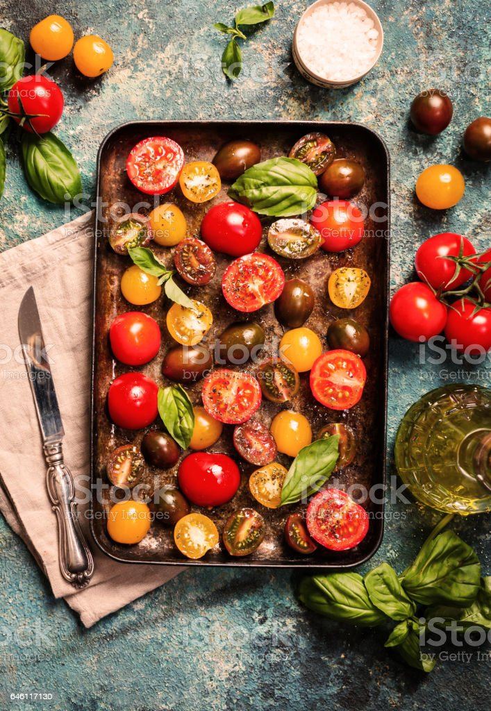 Trays of fresh different color cherry tomatoes ready to sun-dried stock photo