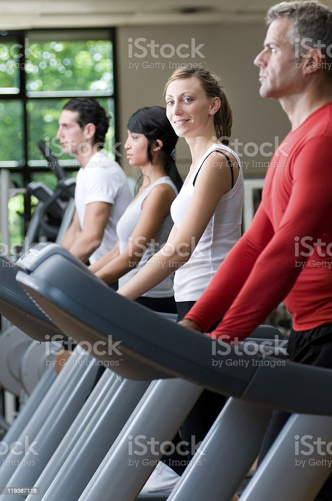 Treadmill exercises at gym royalty-free stock photo