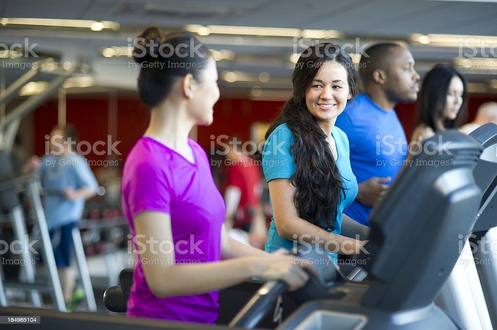 treadmill friends royalty-free stock photo