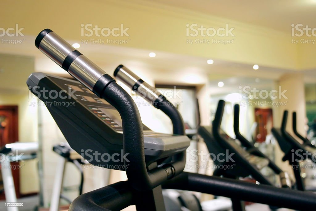 Treadmills at a health club or gym royalty-free stock photo