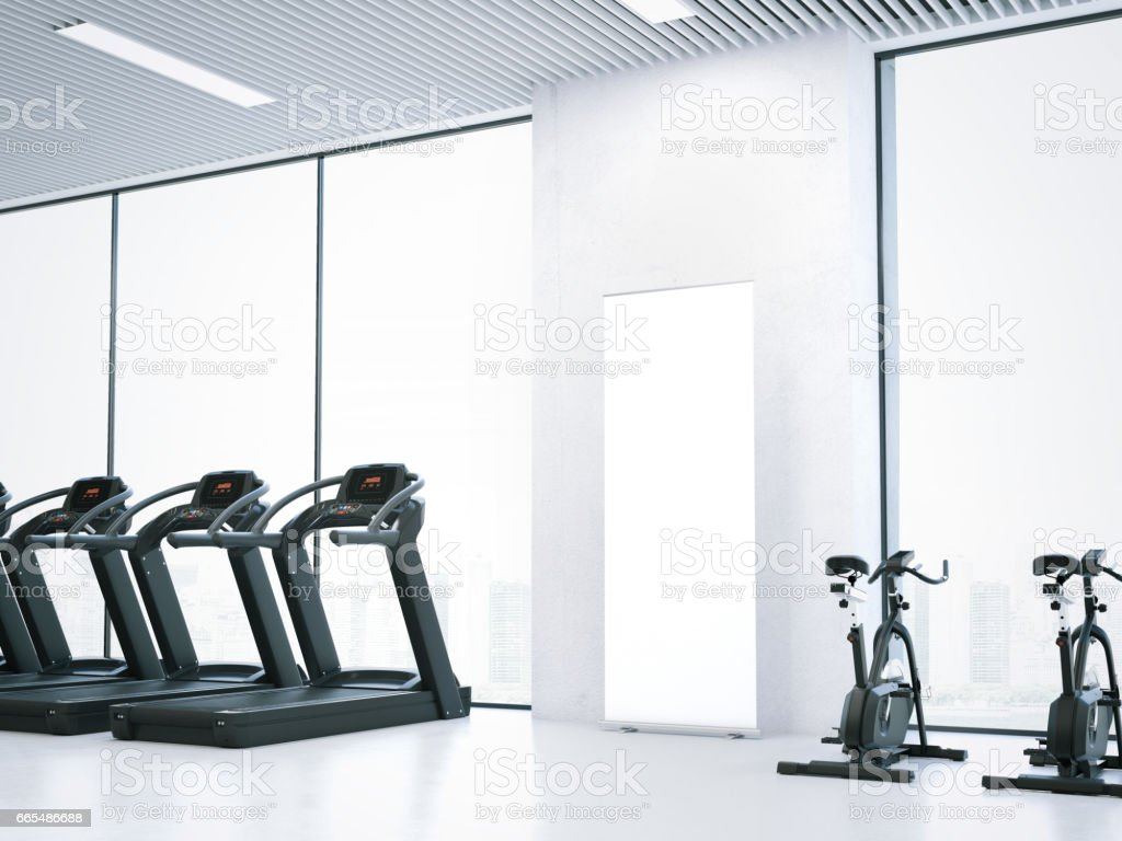 Treadmills, bicycle simulators and blank roll-up bunner. 3d rendering stock photo