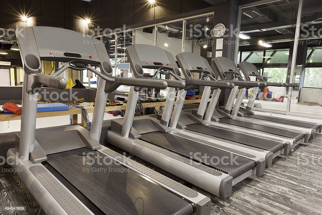 Treadmills in a gym stock photo