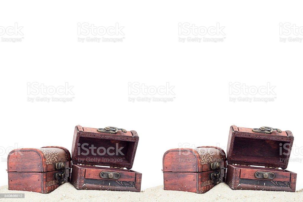 treasure box with sand isolated on white background. stock photo