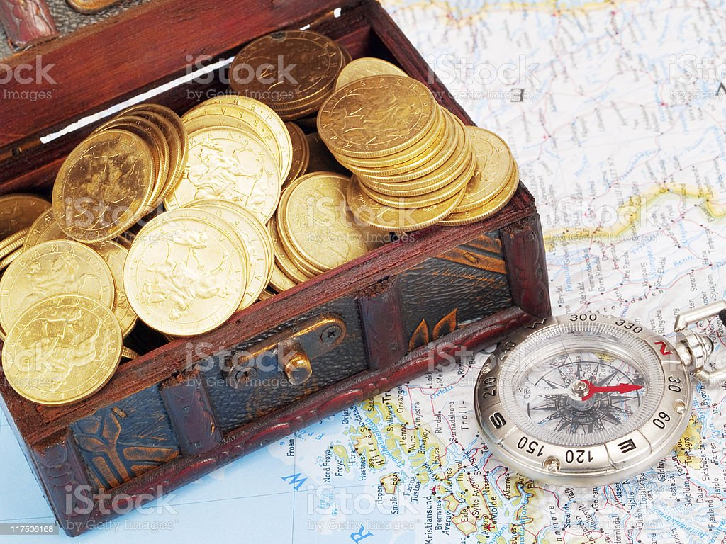 Treasure chest and compass stock photo