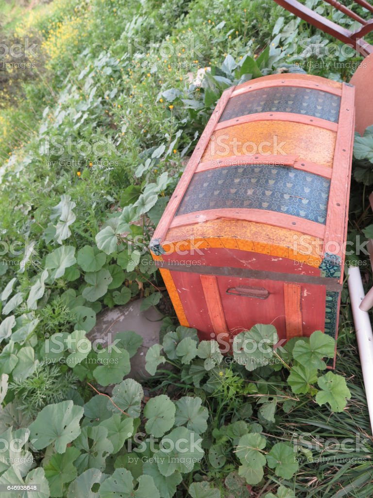 Treasure chest dumped at roadside stock photo