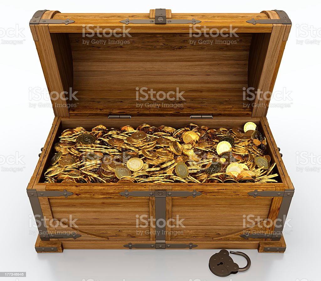 A treasure chest full of gold coins stock photo