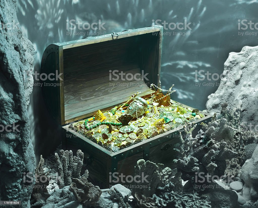 Treasure chest full of gold under the sea stock photo