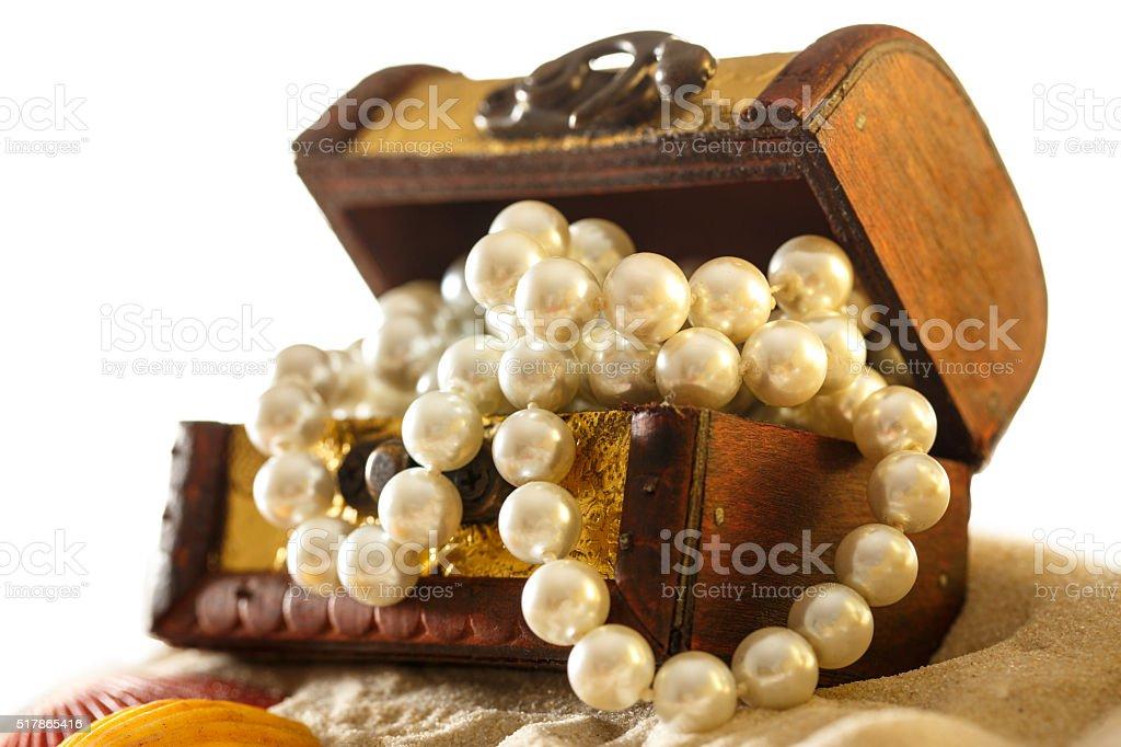 Treasure chest with seashells and pearl stock photo