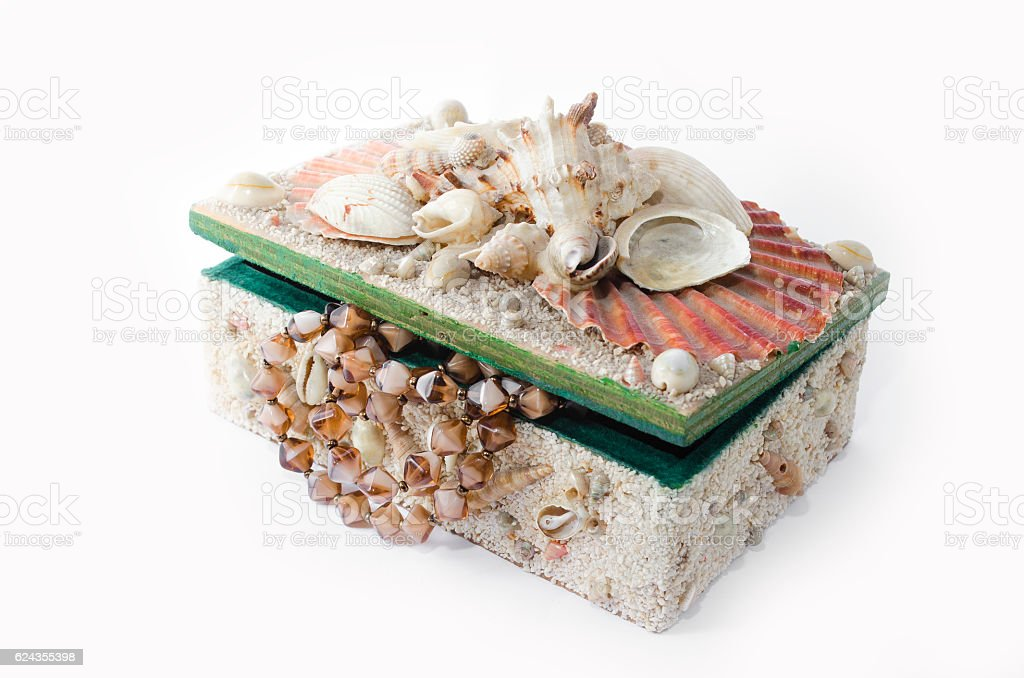 Treasure chest with seashells and pearl royalty-free stock photo