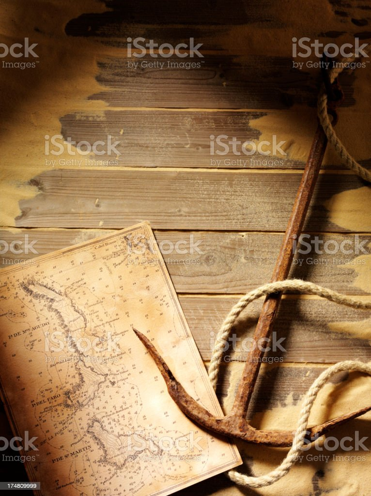 Treasure Map with a Anchor and Rope on Decking royalty-free stock photo