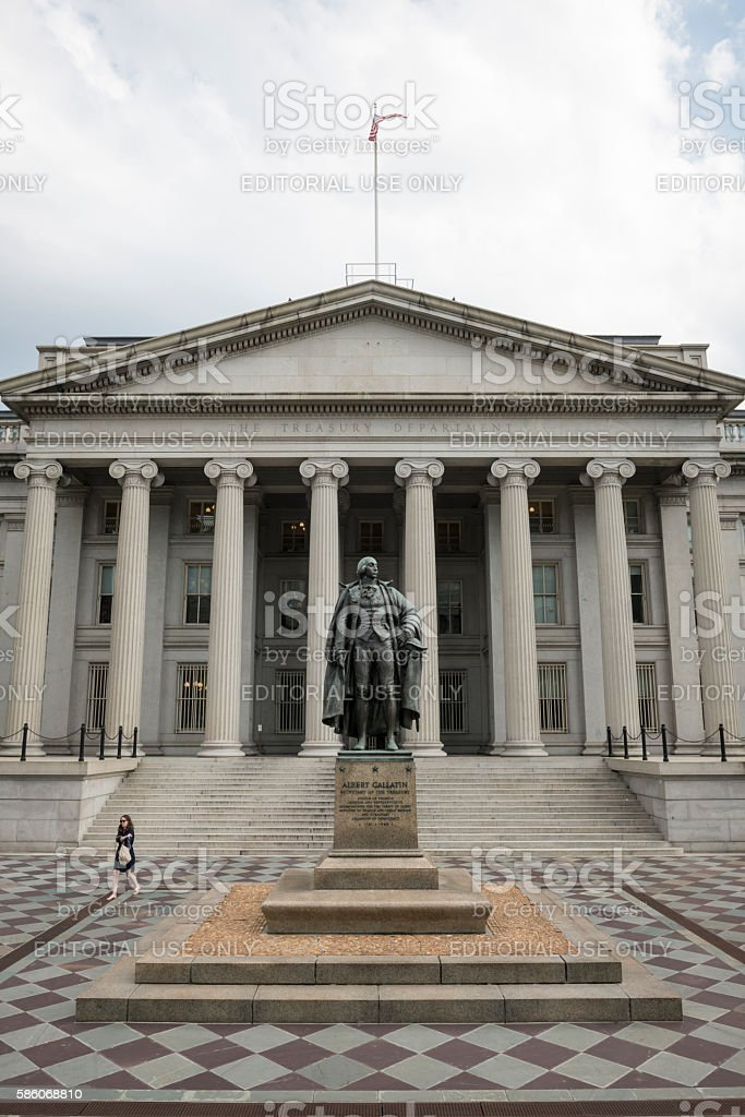 U.S. Treasury Department building and Albert Gallatin statue stock photo