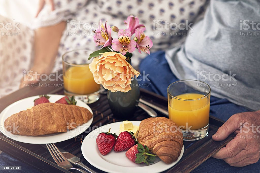 Treat your wife with breakfast in bed stock photo