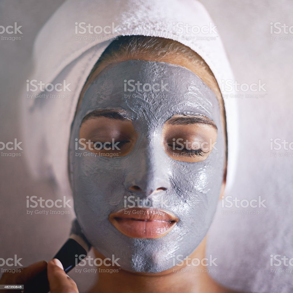 Treating herself to a luxurious facial treatment stock photo