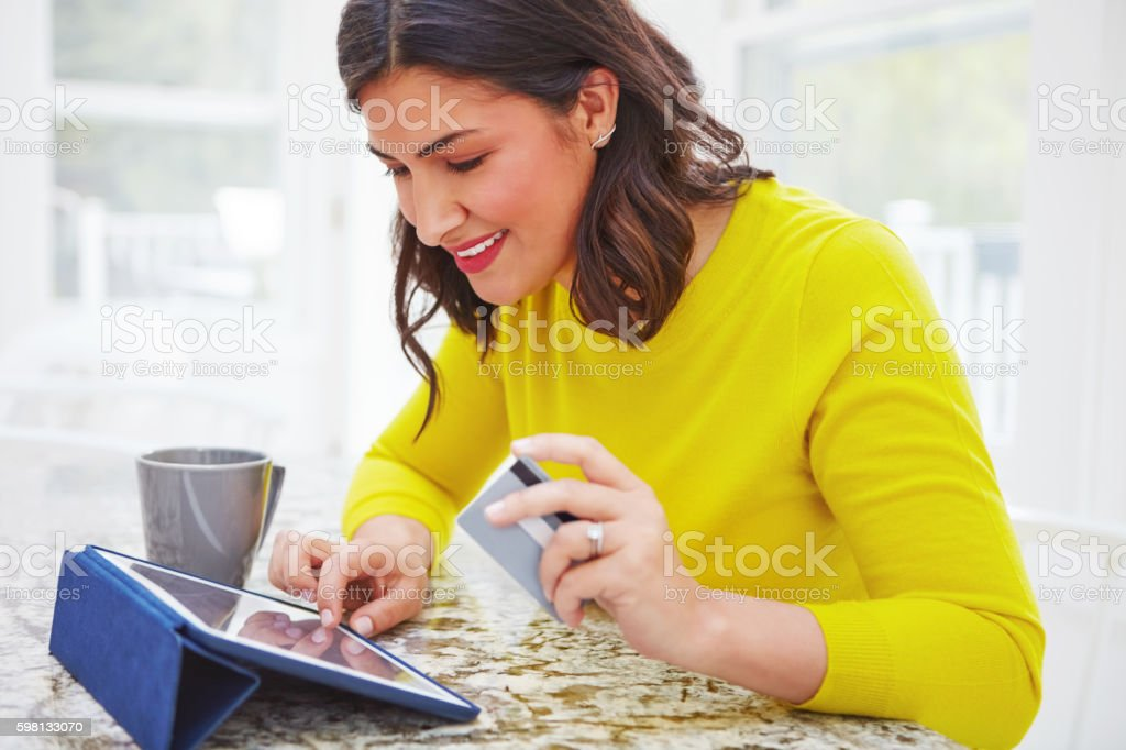 Treating herself to some online retail therapy stock photo