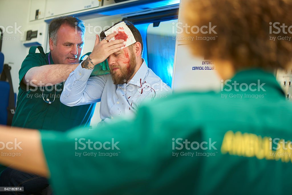 treating the casualty in an ambulance stock photo