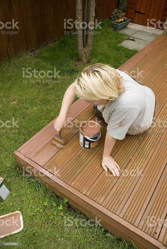 Treating the decking stock photo