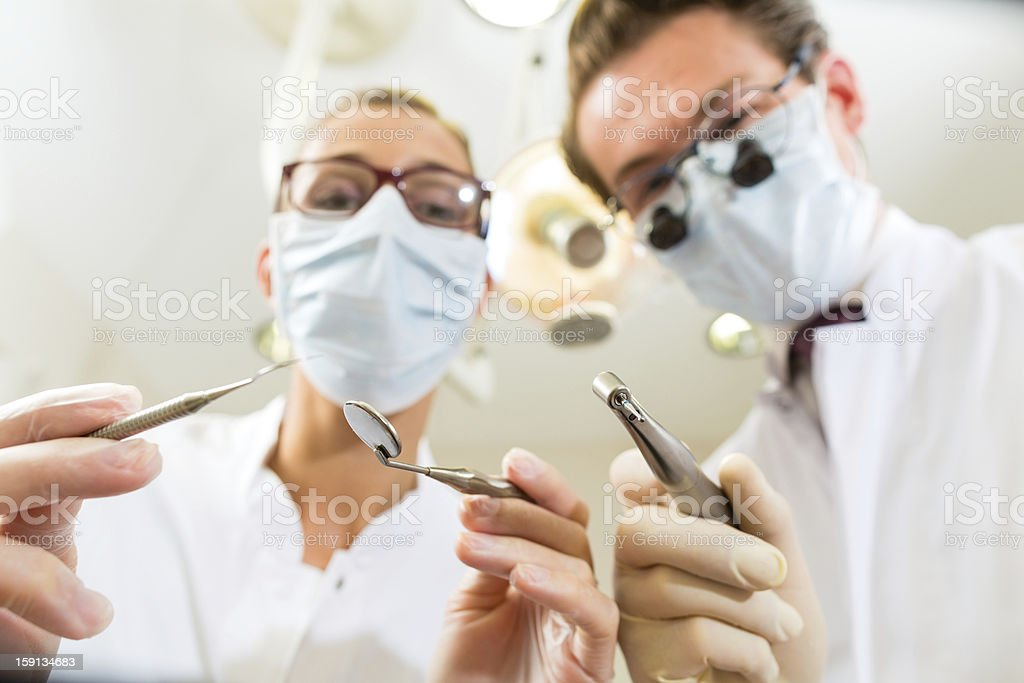 treatment at dentist from perspective of patient royalty-free stock photo