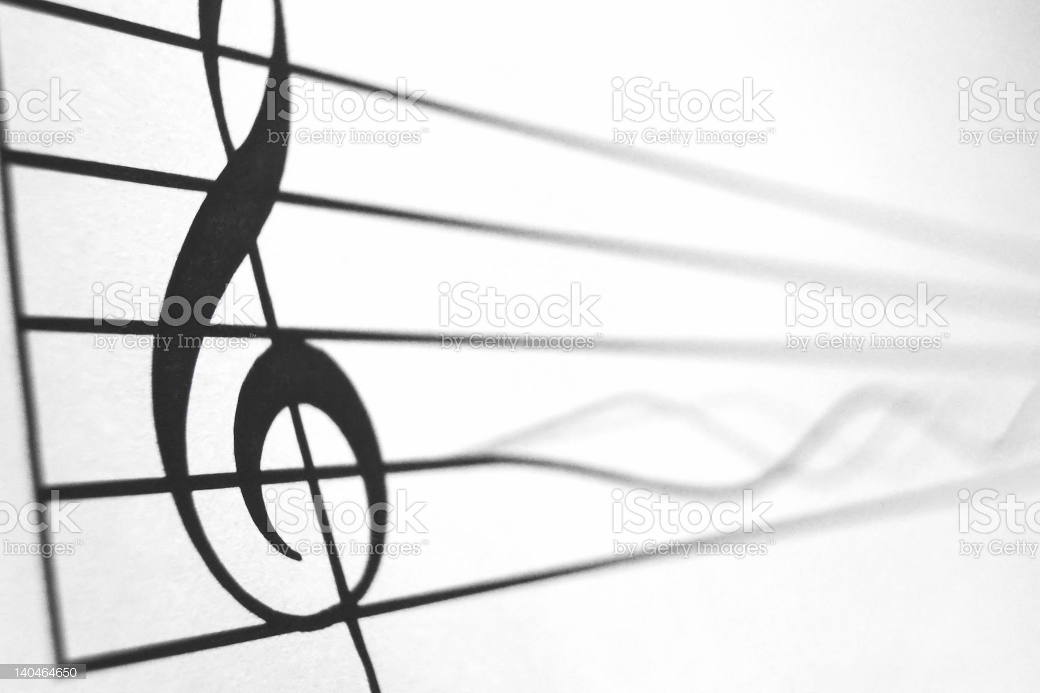 Treble clef in score and a vibrating string royalty-free stock photo