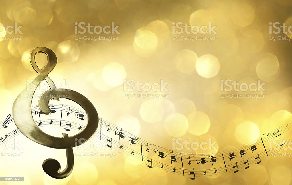 Treble Clef Infront Of Defocused Light stock photo