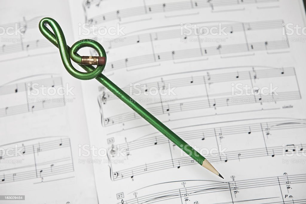 Treble Clef Pencil and Sheet Music royalty-free stock photo