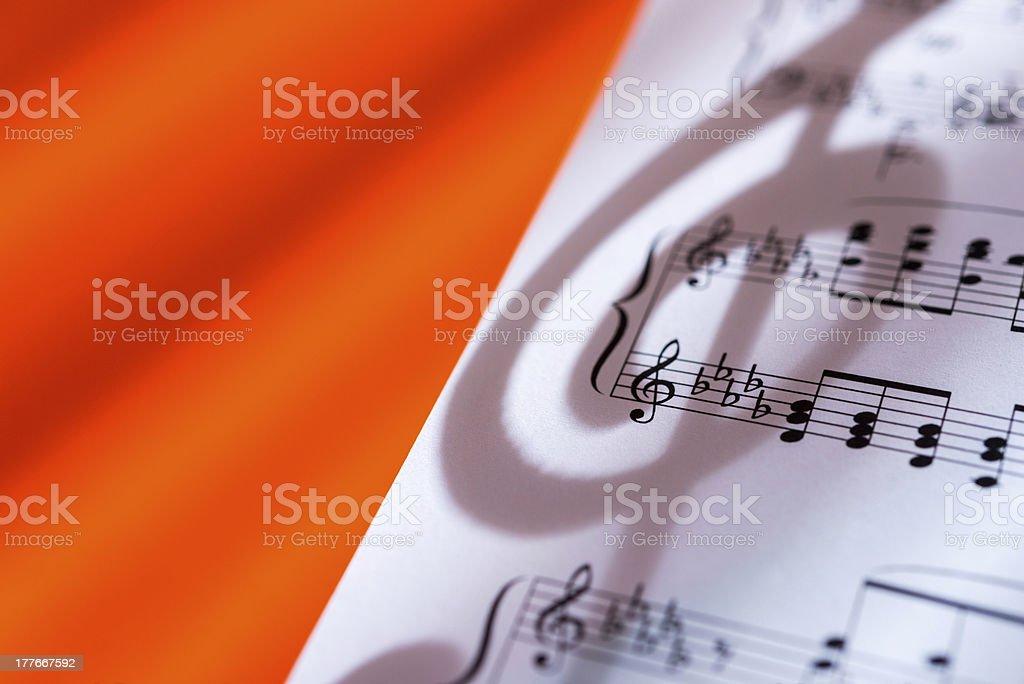 Treble Clef shadow on music sheet royalty-free stock photo