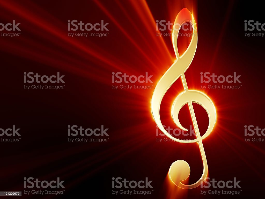 Treble clef  shining on black. Background royalty-free stock photo
