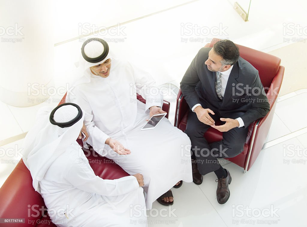 Tree arab businessmen in meeting, with tablet stock photo