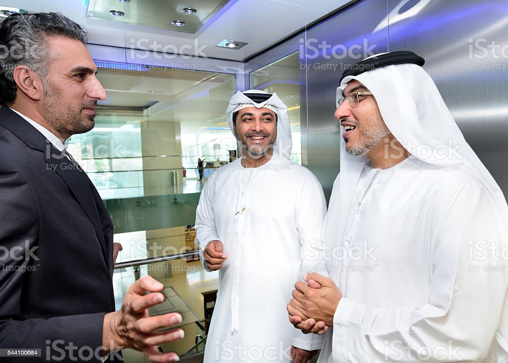 Tree arab businessmen meeting in elevator stock photo