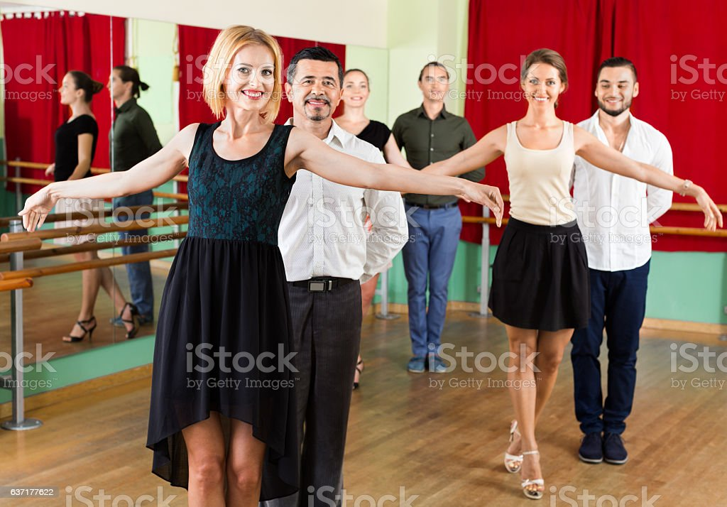 Tree cheerful  couples dancing waltz stock photo