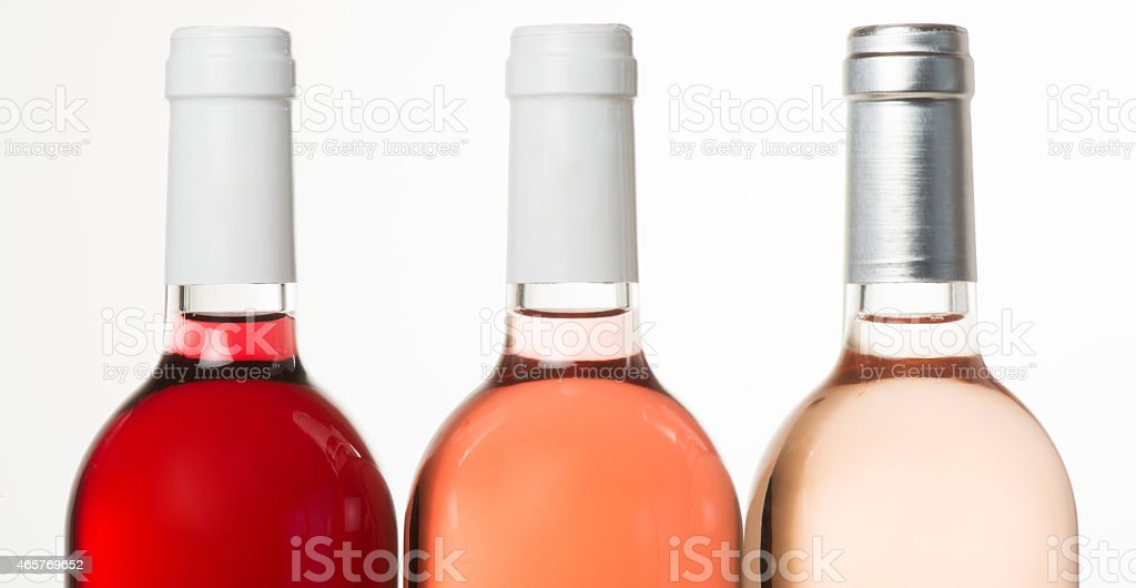 Tree colors of Rose wine in bottle stock photo