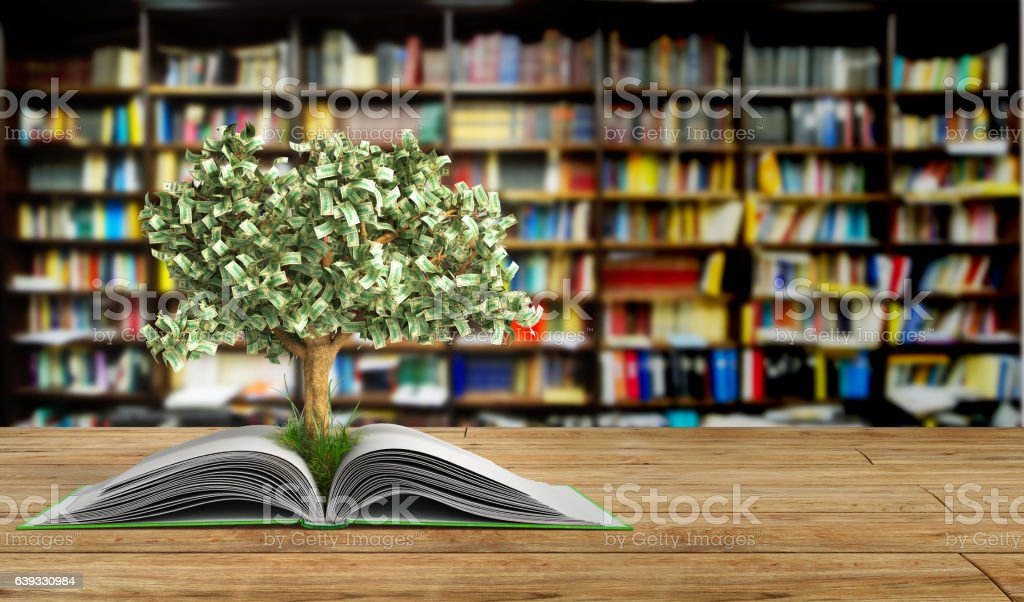 tree growing from book A big open book stock photo